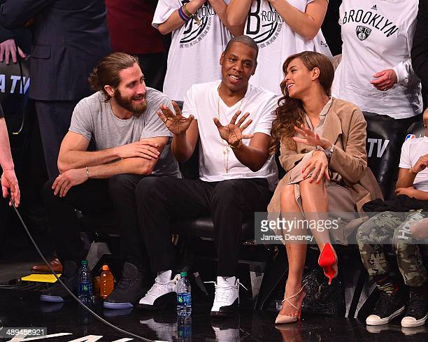 Jake Gyllenhaal JayZ and Beyonce Knowles attend the Miami Heat vs Brooklyn Nets playoff game at Barclays Center on May 10 2014 in the Brooklyn...