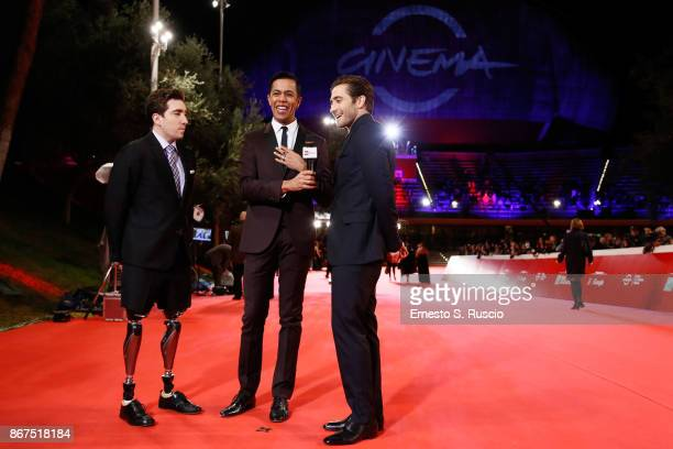 Jake Gyllenhaal Jeff Bauman are interviewed by Livio Beshir on the red carpet for 'Stronger' during the 12th Rome Film Fest at Auditorium Parco Della...
