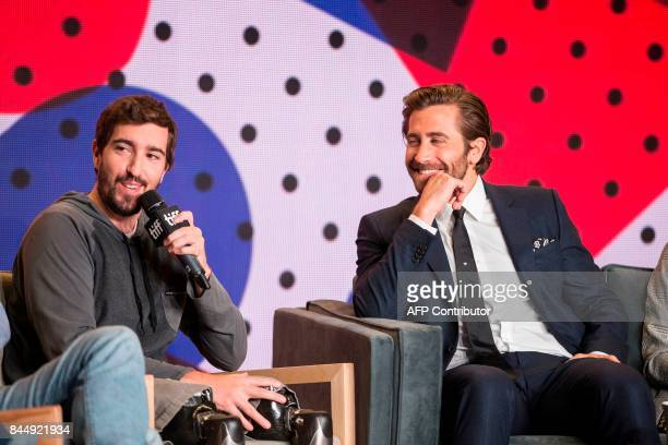 Jake Gyllenhaal listens as Jeff Bauman speaks during the press conference for Stronger at the Toronto International Film Festival in Toronto on...