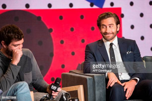 Jake Gyllenhaal looks at Jeff Bauman during the press conference for Stronger at the Toronto International Film Festival in Toronto on September 9...