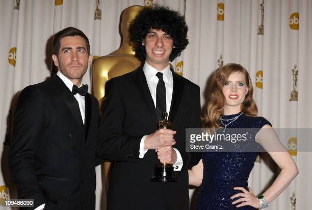Jake Gyllenhaal, Luke Matheny and Amy Adams pose in the press room during the 83rd Annual Academy Awards held at the Kodak Theatre on February 27,...