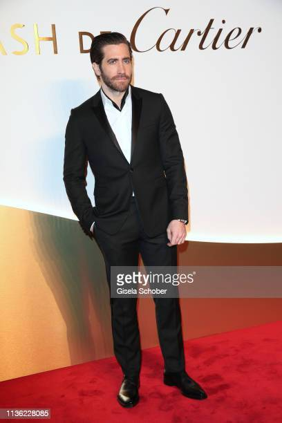 Jake Gyllenhaal wearing the watch 'Santos' by Cartier during the Clash de Cartier event at la Conciergerie on April 10 2019 in Paris France
