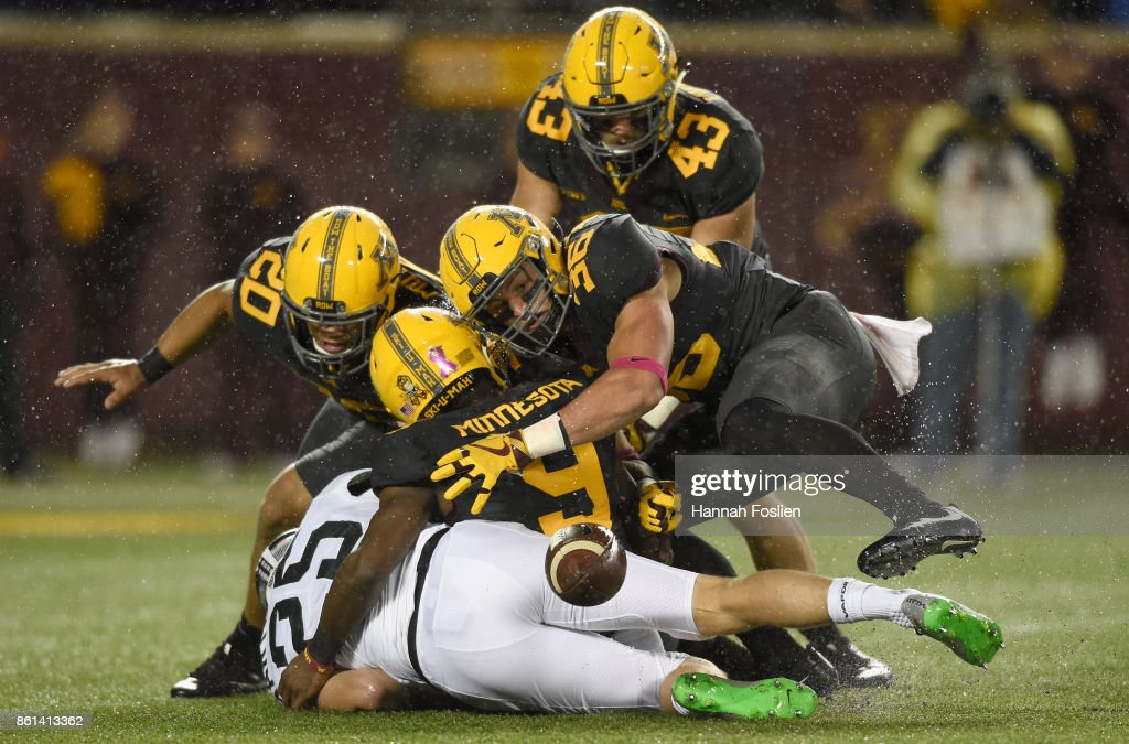 Jake Hartbarger of the Michigan State Spartans fumbles the ...