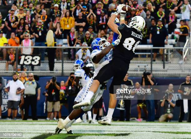 Jake Hescock of the UCF Knights catches a touchdown pass over Curtis Akins of the Memphis Tigers during the second quarter of the American Athletic...
