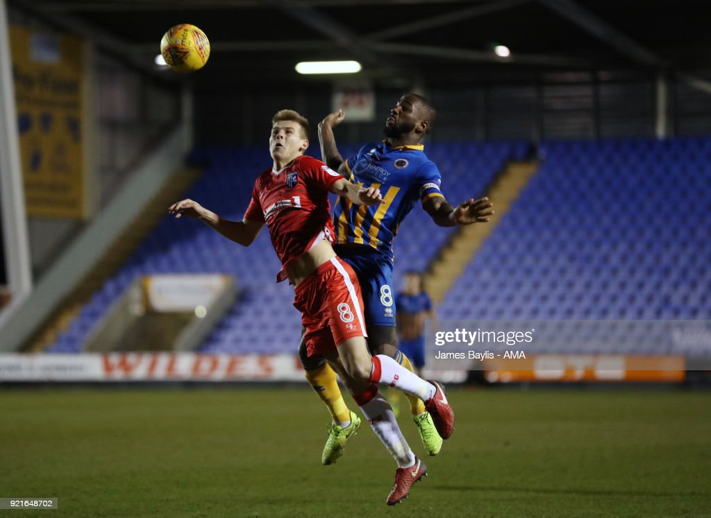 Jake Hessenthaler of Gillingham and Abu Ogogo of Shrewsbury Town during the Sky Bet League One match between Shrewsbury Town and Gillingham at New Meadow on February 20, 2018 in Shrewsbury, England.