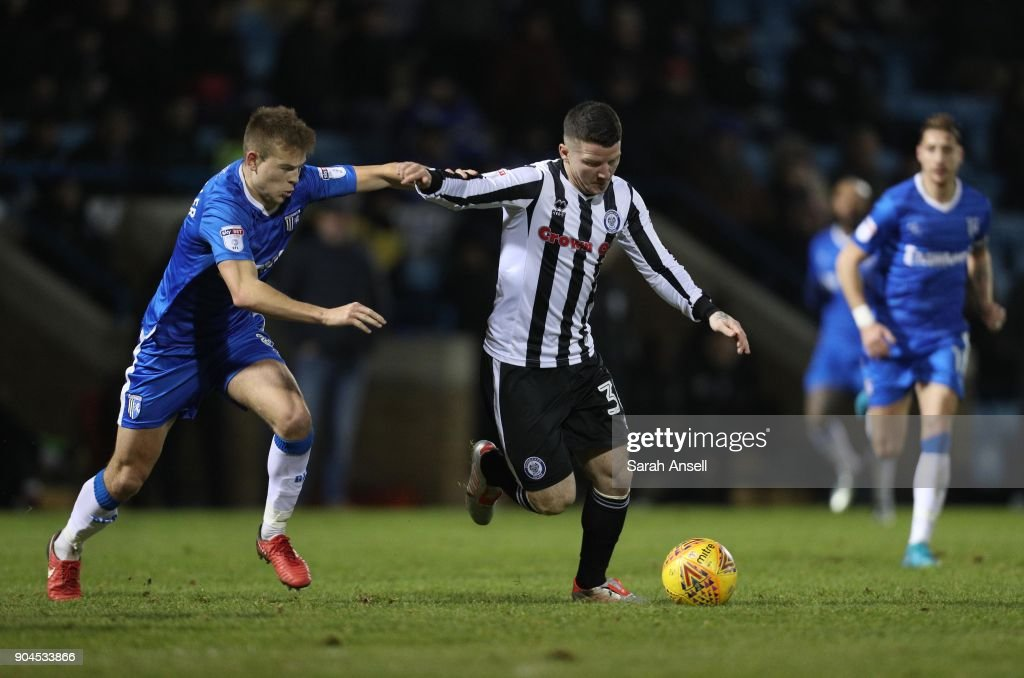 Jake Hessenthaler of Gillingham (L) challenges Billy Knott of Rochdale (R) during the Sky Bet League One match between Gillingham and Rochdale at Priestfield Stadium on January 13, 2018 in Gillingham, England. (Photo by Sarah Ansell/Getty Images).