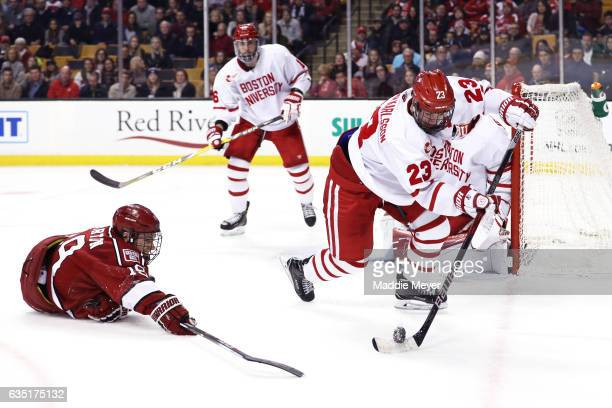 Jake Horton of the Harvard Crimson dives to defend Jakob Forsbacka Karlsson of the Boston University Terriers during the second period of the 2017...