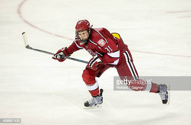Jake Horton of the Harvard Crimson skates during NCAA hockey against the Boston College Eagles at Kelley Rink on November 11, 2014 in Chestnut Hill,...