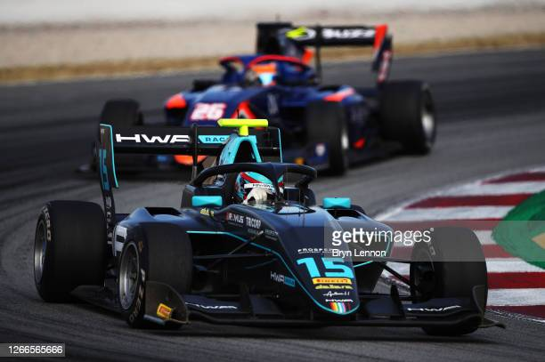 Jake Hughes of Great Britain and HWA Racelab leads Clement Novalak of Great Britain and Carlin Buzz Racing during race two of the Formula 3...