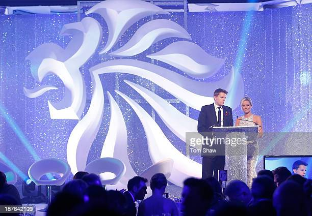 Jake Humpheys and Denise Van Outen present the show during the British Olympic Ball at The Dorchester on October 30 2013 in London England