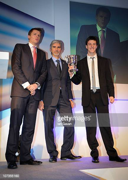 Jake Humphrey and Damon Hill present James Calado with the Spencer Charrington Trophy at the British Racing Drivers' Club Awards at The Savoy on...