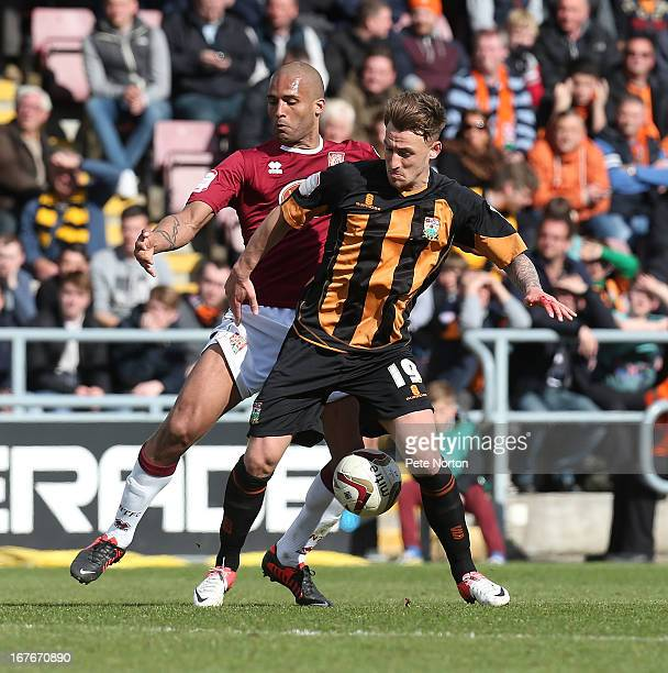 Jake Hyde of Barnet contests the ball with Clarke Carlisle of Northampton Town during the npower league Two match between Northampton Town and Barnet...