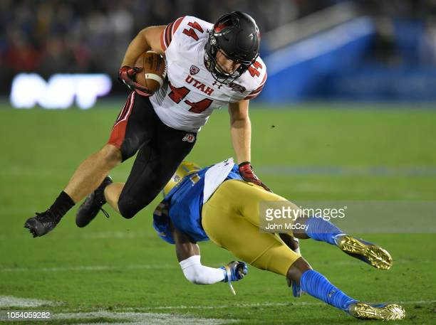 Jake Jackson of the Utah Utes runs into Darnay Holmes of the UCLA Bruins in the first hafl at the Rose Bowl on October 26 2018 in Pasadena California