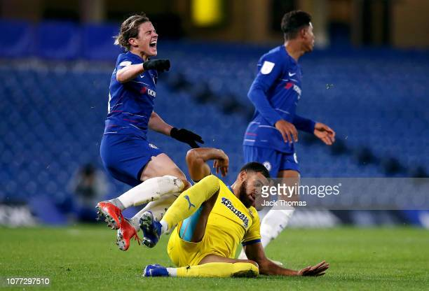 Jake Jervis of AFC Wimbledon tackles Conor Gallagher of Chelseas during the Checkatrade Trophy second round match between Chelsea U21 and AFC...