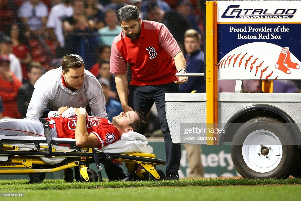 Jake Jewell #65 of the Los Angeles Angels is carted off the field after he injured his right ankle when he slid into home plate in a failed attempt to tag out J.D. Martinez #28 of the Boston Red Sox in the eighth inning of a game at Fenway Park on June 27, 2018 in Boston, Massachusetts.