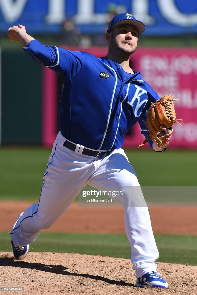 Jake Junis #65 of the Kansas City Royals pitches against the Chicago Cubs during the spring training game at Surprise Stadium on March 1, 2017 in Surprise, Arizona.