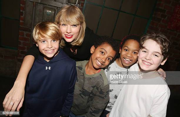 Jake Katzman Taylor Swift Devin Trey Campbell Jesus Del Orden and Christopher Convery pose backstage with the cast at the hit musical Kinky Boots on...