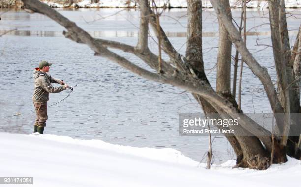 Jake Kelley of Edgecomb casts his line into the Androscoggin River Sunday while on a shopping trip with his mom Andrea and grandmother Peggy Olson of...