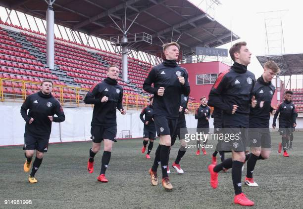 Jake Kenyon Ethan Hamilton Max Dunne George Tanner and Lee O'Connor of Manchester United U19s in action during a training session at Vozdovac Stadium...