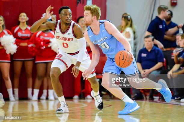 Jake Killingsworth of the Columbia Lions is defended by Mustapha Heron of the St. John's Red Storm at Carnesecca Arena on November 20, 2019 in New...