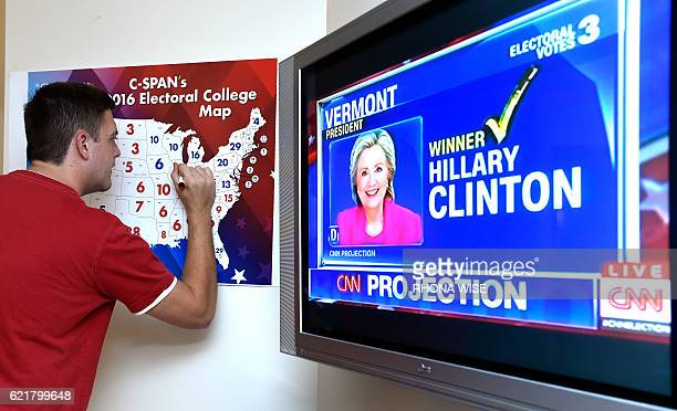 Jake Krupa colors in an electoral map as states projected for Republican presidential nominee Donald Trump or Democratic Presidential nominee Hillary...