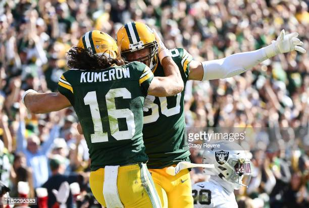 Jake Kumerow of the Green Bay Packers celebrates with Jimmy Graham after scoring a touchdown during the second quarter against the Oakland Raiders in...