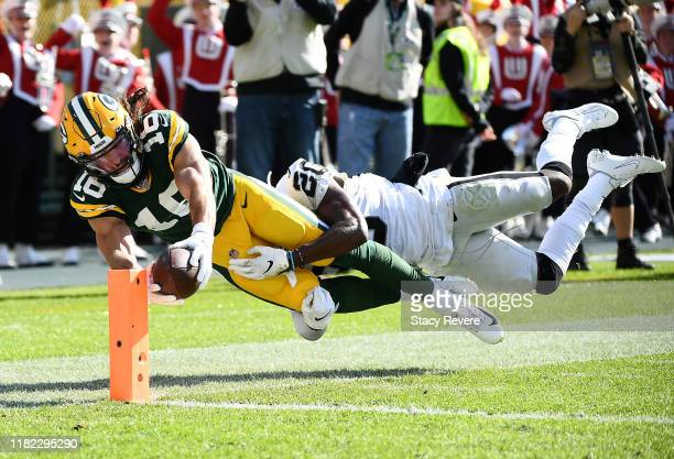 Jake Kumerow of the Green Bay Packers dives for the pylon to score a touchdown during the second quarter as Daryl Worley of the Oakland Raiders is...