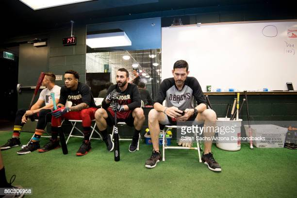 Jake Lamb Ketel Marte Daniel Descalso and Tim Laker of the Arizona Diamondbacks work out in the batting cages the day before game three of the...
