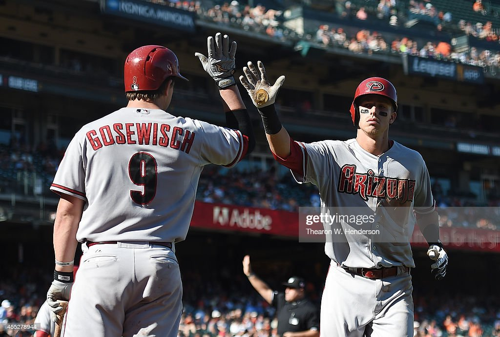 Jake Lamb #19 of the Arizona Diamondback is congratulated by Tuffy Gosewisch #9 after Lamb hit a solo home run in the top of the ninth inning against the San Francisco Giants at AT&T Park on September 11, 2014 in San Francisco, California. The Giants won the game 6-2.