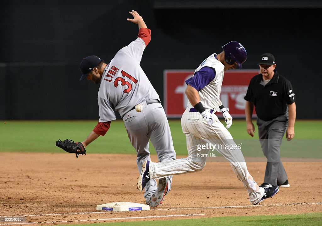 Jake Lamb #22 of the Arizona Diamondbacks beats out the throw to first base as the ball gets away from Lance Lynn #31 of the St Louis Cardinals during the sixth inning at Chase Field on June 29, 2017 in Phoenix, Arizona.