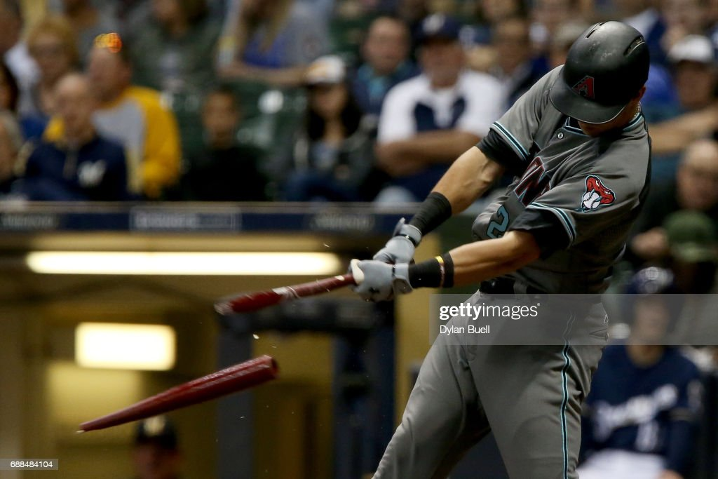 Jake Lamb #22 of the Arizona Diamondbacks breaks his bat on a ground out in the eighth inning against the Milwaukee Brewers at Miller Park on May 25, 2017 in Milwaukee, Wisconsin.