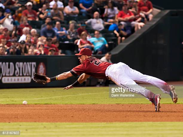 Jake Lamb of the Arizona Diamondbacks dives for the ball in the seventh inning of the MLB game against the San Diego Padres at Chase Field on October...