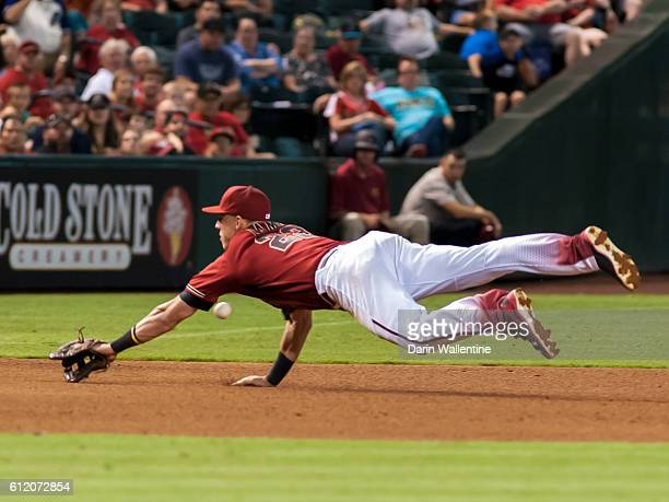 Jake Lamb of the Arizona Diamondbacks dives for the ball off the bat of Luis Sardinas of the San Diego Padres in the seventh inning of the MLB game...