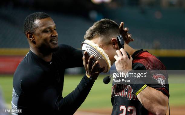 Jake Lamb of the Arizona Diamondbacks gets a pie in his face from teammate Adam Jones following a 7-5 victory against the Miami Marlins during the...