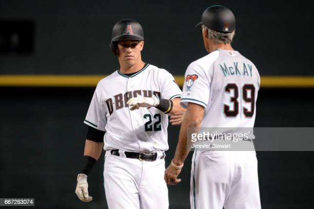 Jake Lamb of the Arizona Diamondbacks high fives first base coach Dave McKay after singling against the Cleveland Indians in the fourth inning at...