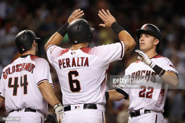 Jake Lamb of the Arizona Diamondbacks high fives Paul Goldschmidt and David Peralta after hitting a tworun home run against the San Diego Padres...