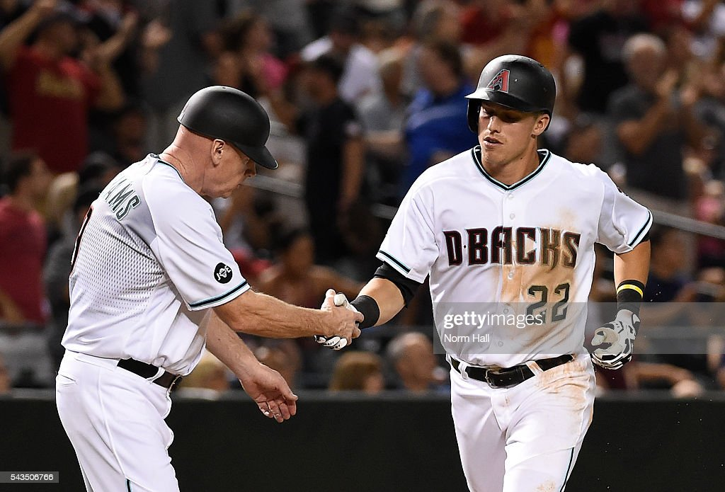 Jake Lamb #22 of the Arizona Diamondbacks is congratulated by third base coach Matt Williams #9 after hitting a solo home run during the seventh inning against the Philadelphia Phillies at Chase Field on June 28, 2016 in Phoenix, Arizona.
