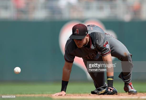 Jake Lamb of the Arizona Diamondbacks is unable to field a ball hit by Byron Buxton of the Minnesota Twins during the third inning of the game on...