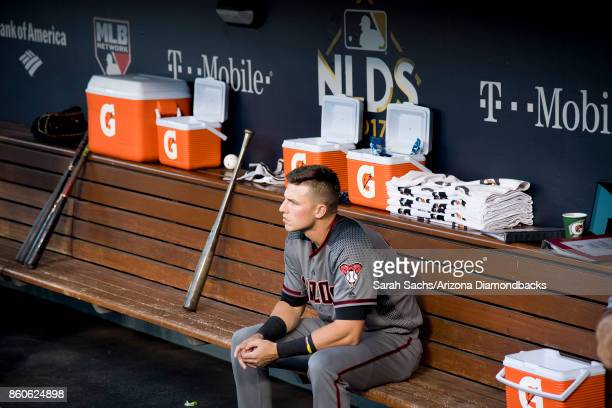 Jake Lamb of the Arizona Diamondbacks sits in the dugout prior to Game Two of the National League Division Series against the Los Angeles Dodgers at...