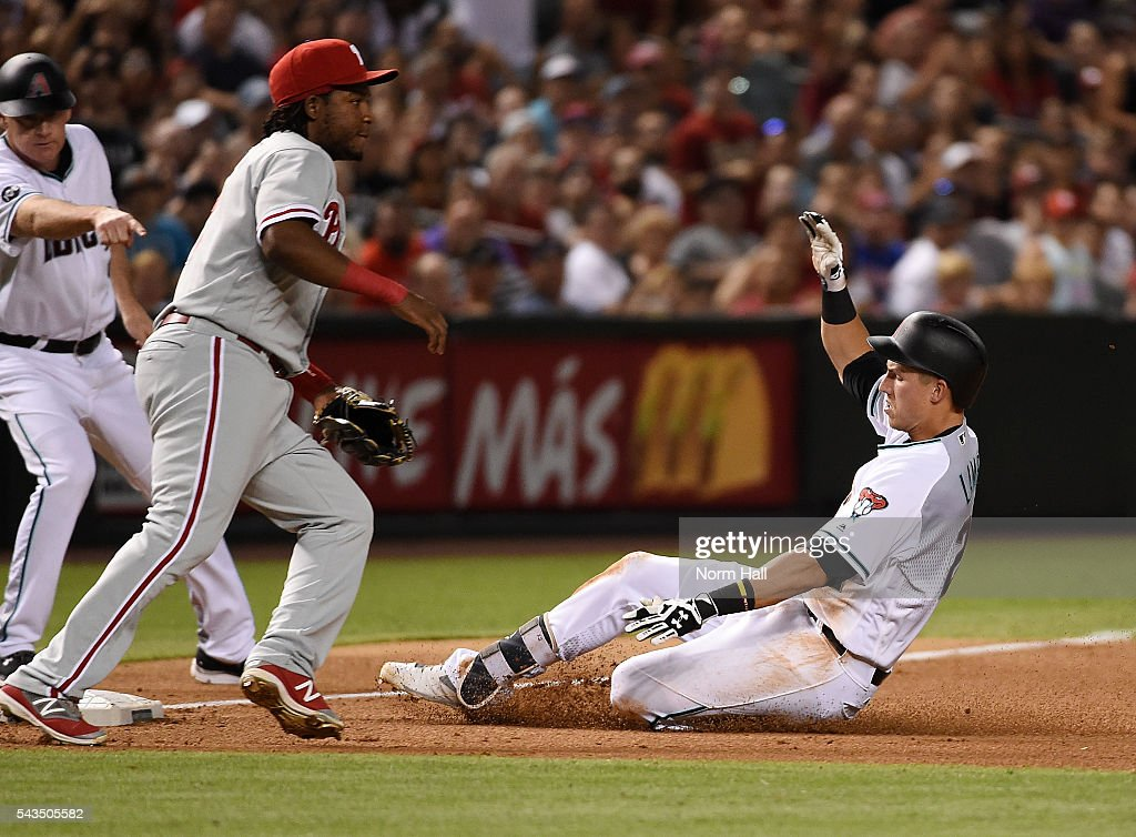 Jake Lamb #22 of the Arizona Diamondbacks slides safely into third base with a lead off triple as Maikel Franco #7 of the Philadelphia Phillies waits for the throw to come in from the outfield during the fourth inning at Chase Field on June 28, 2016 in Phoenix, Arizona.