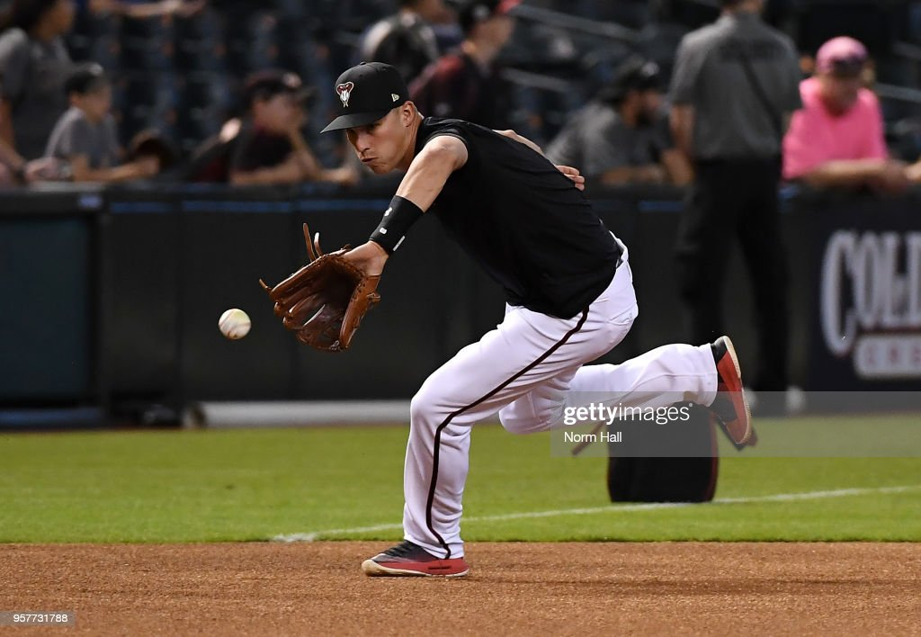 Jake Lamb #22 of the Arizona Diamondbacks takes ground balls prior to a game against the Washington Nationals at Chase Field on May 12, 2018 in Phoenix, Arizona.