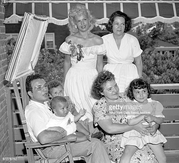 Jake LaMotta holds 2yearold Jackie and Joe 8 months as his mother holds daughter Jacqueline 4 Jake's blonde wife Vickie and her mother Mrs Margaret...