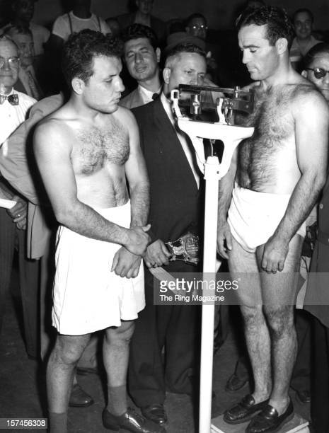 Jake LaMotta looks on as he watches Marcel Cerdan as he weighs in before the fight at Briggs Stadium, on June 16,1949 in Detroit, Michigan. Jake...