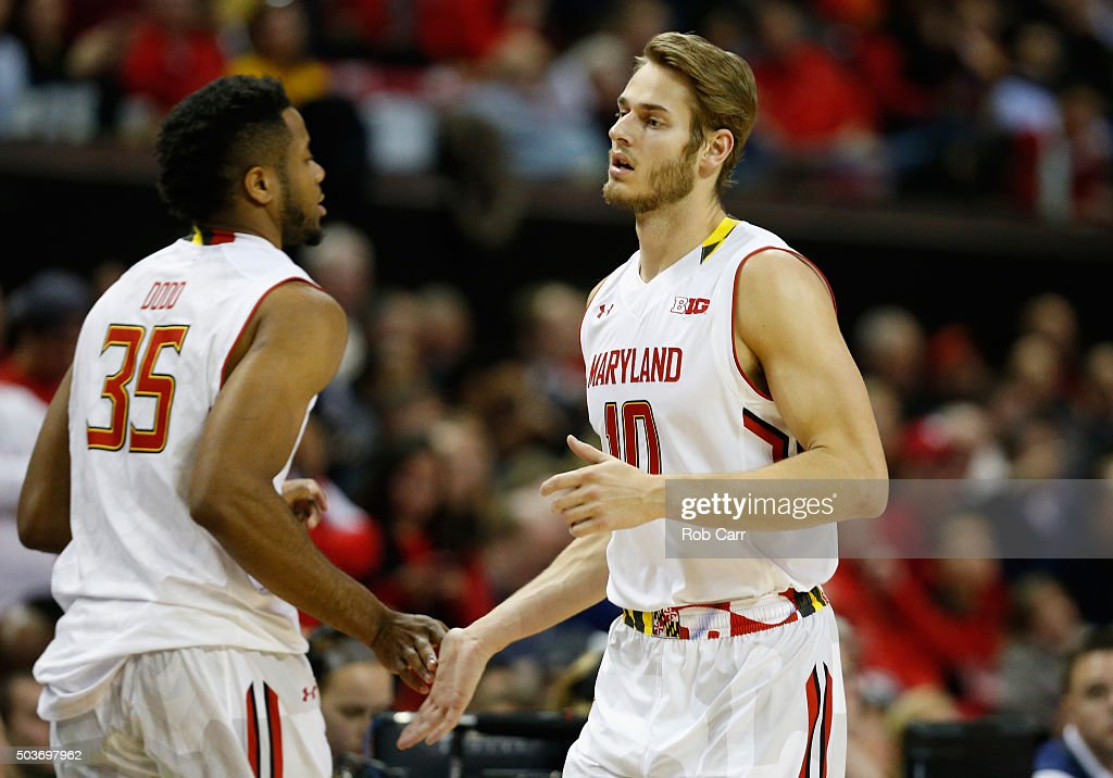 Jake Layman of the Maryland Terrapins celebratres with ...