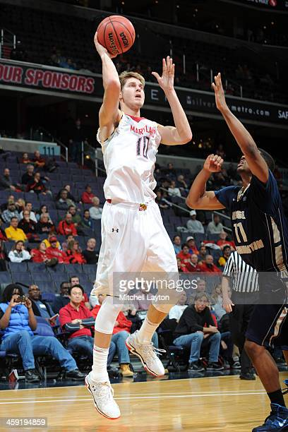 Jake Layman of the Maryland Terrapins takes a shot during the BBT Classic college basketball game against the George Washington Colonials on December...