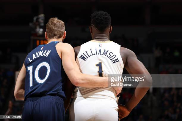 Jake Layman of the Minnesota Timberwolves and Zion Williamson of the New Orleans Pelicans looks on during the game on March 8 2020 at Target Center...