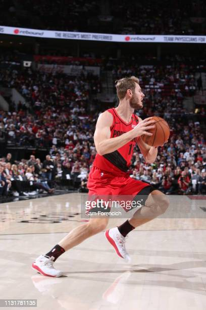 Jake Layman of the Portland Trail Blazers handles the ball against the Dallas Mavericks on March 20 2019 at the Moda Center Arena in Portland Oregon...