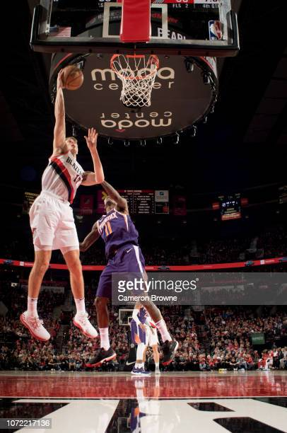Jake Layman of the Portland Trail Blazers shoots the ball against the Phoenix Suns on December 6 2018 at the Moda Center Arena in Portland Oregon...