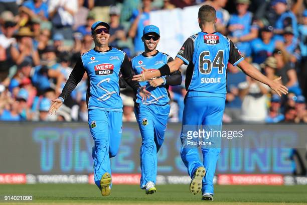 Jake Lehmann and Peter Siddle of the Strikers celebrate the wicket of George Bailey of the Hurricanes during the Big Bash League Final match between...