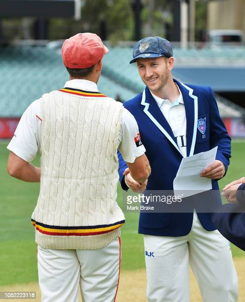 Jake Lehmann captain of the Redbacks and Peter Nevill captain of the Blues shake hands before coin toss during the Sheffield Shield match between...